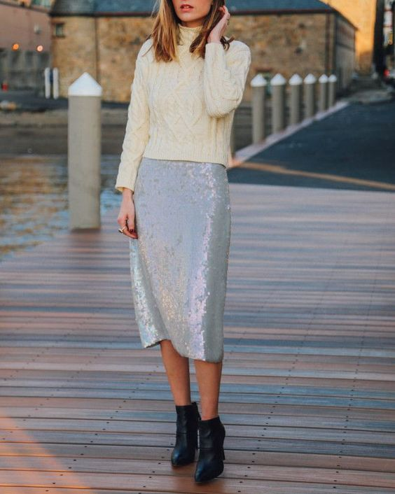 a white sequin midi and an ivory turtleneck sweater