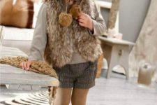 22 shorts, a neutral jersey, a faux fur vest and tall boots, a beanie