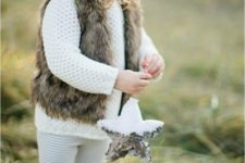 23 white kint sweater, leggings, a faux fur vest and a beanie