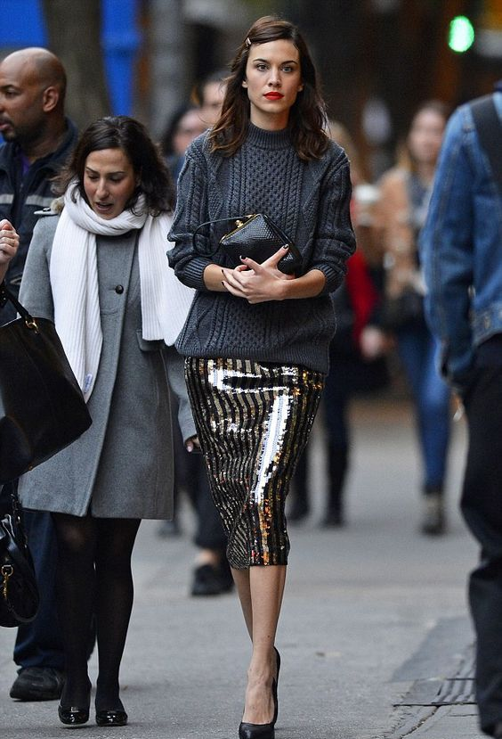 grey jumper and a glitzy skirt for a comfy and bold look