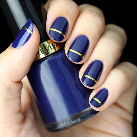 royal blue nails with a gold stripe