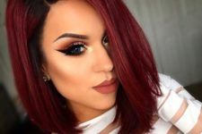 27 rock black roots with red hair to give it a more eye-catchy look