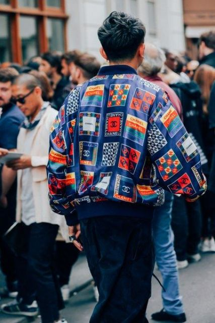 Printed bomber jacket with navy blue pants
