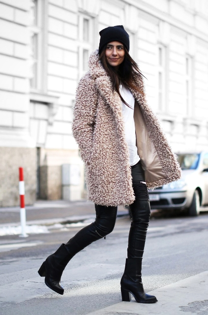 With beanie, white shirt, skinny leather pants and mid calf boots