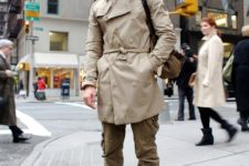 With beige coat and sporty pants