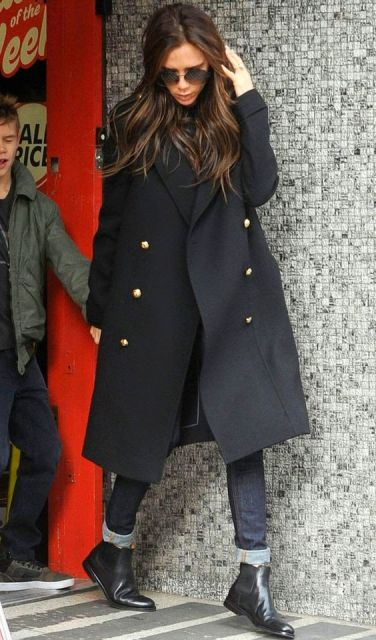 With black double breasted coat and cuffed jeans
