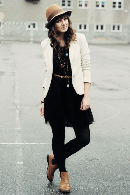 With black dress, tights, white jacket and hat