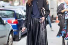 With black leather pleated midi skirt, black jacket and clutch