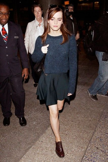 With black mini skirt and navy blue sweater