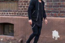 With black oversized shirt, black jacket, pants and beanie