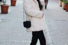 With black pants, faux fur coat and mini bag