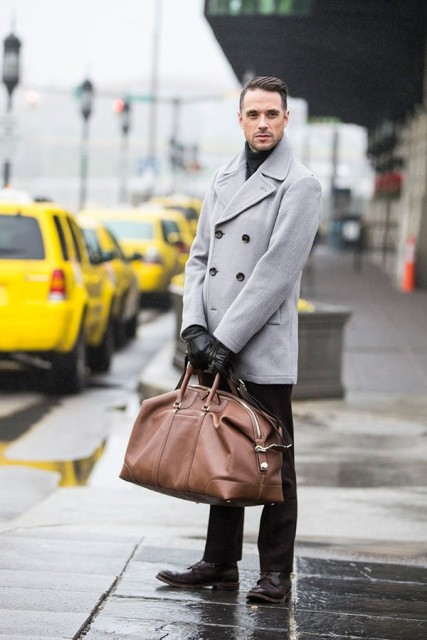 Winter work look with black pants, leather shoes and big brown bag