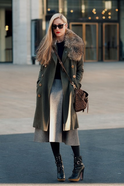 With black shirt, midi skirt, heeled boots and crossbody bag