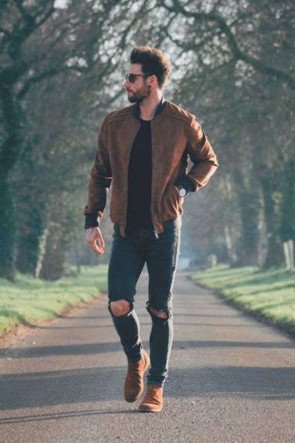 With black t-shirt, distressed jeans and suede boots