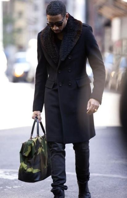 With black trousers, boots and big bag