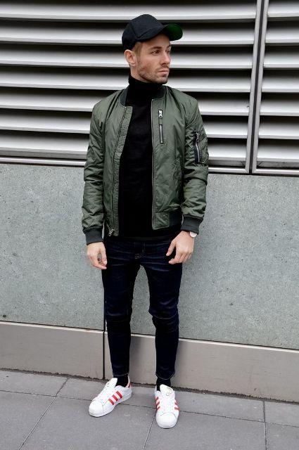 With black turtleneck, crop pants, sneakers and cap