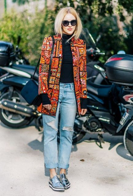 With black turtleneck, printed coat and cuffed jeans