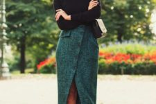 With black turtleneck, wrap skirt and mini bag
