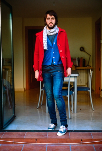 With blue jacket, jeans, sneakers and scarf