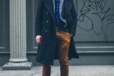 With blue shirt, gray blazer, brown pants and light brown shoes