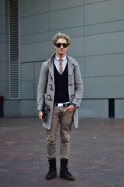 With button down shirt, black vest, gray trousers and mid calf boots