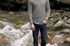 With button down shirt, gray sweater and cuffed jeans