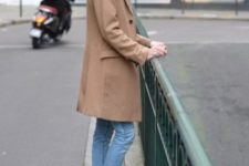 With camel coat and classic jeans