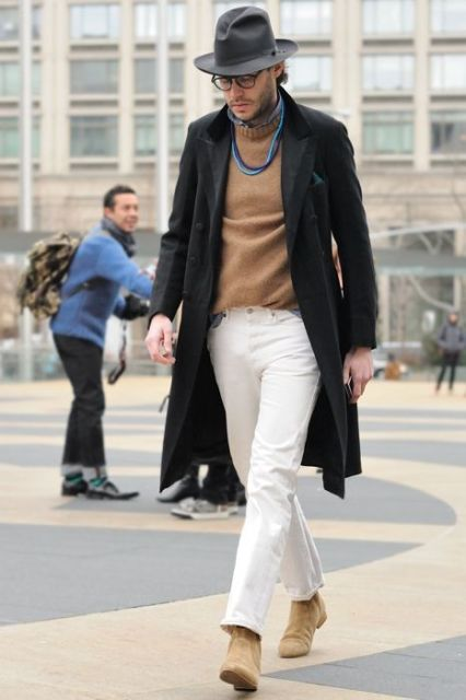 With camel sweater, white straight trousers, black coat and hat
