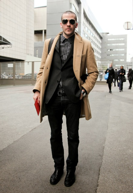 With checked shirt, black blazer, pants and shoes