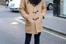 With cuffed jeans, brown shoes and oversized scarf