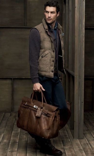 With denim shirt, cardigan, pants and big bag