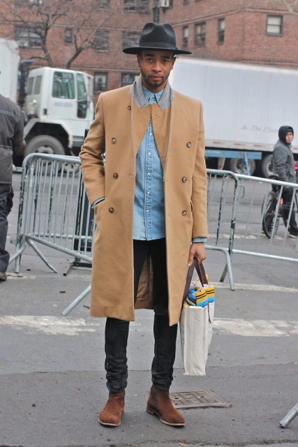With denim shirt, deep gray pants, hat and brown suede boots