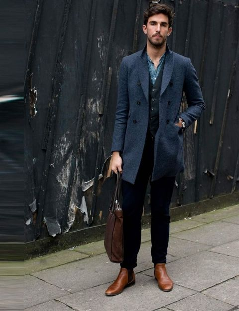 Picture Of With denim shirt, vest, black pants and brown shoes