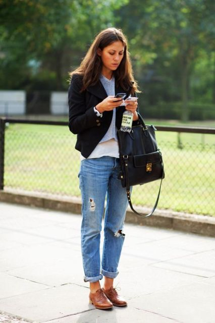 With distressed jeans and black jacket