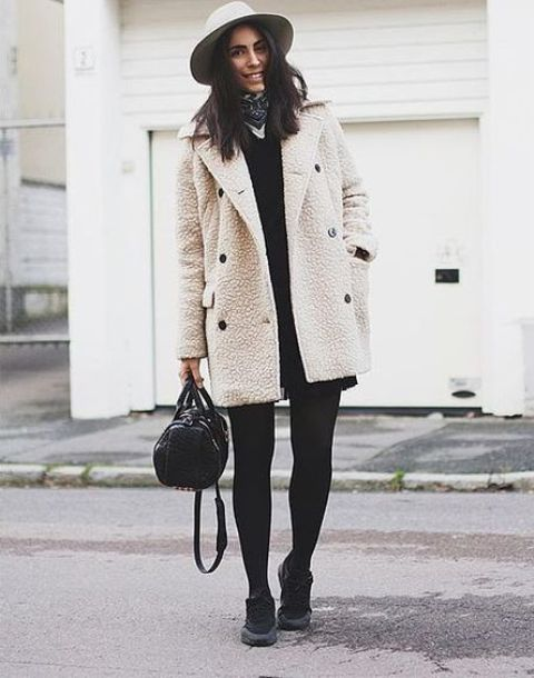 With felt hat, black dress and sneakers