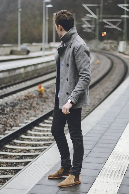 With gray jacket and black pants