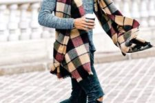 With gray sweater, printed scarf and distressed jeans
