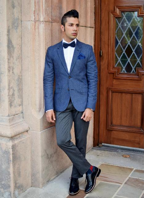 With gray trousers, blue jacket, white shirt and navy blue bow tie