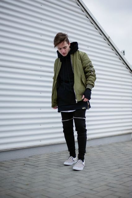 With hooded sweatshirt, black pants and printed shoes