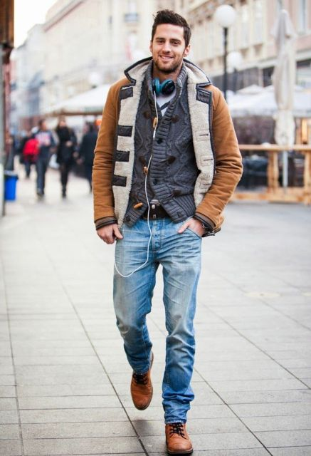 With knitted blazer, straight jeans and brown boots