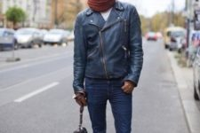 With leather jacket, jeans and knitted scarf