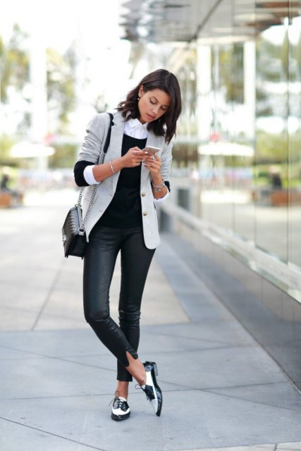 With leather pants, jacket and chain strap bag