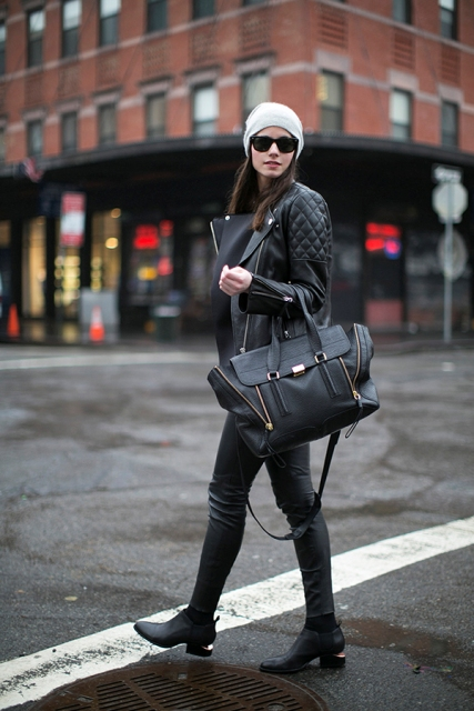 With leather pants, jacket, bag and gray beanie