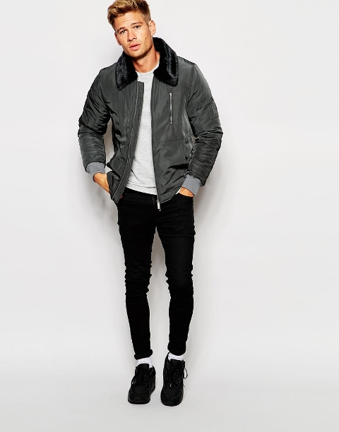 With light gray sweater, black skinny pants and black sneakers