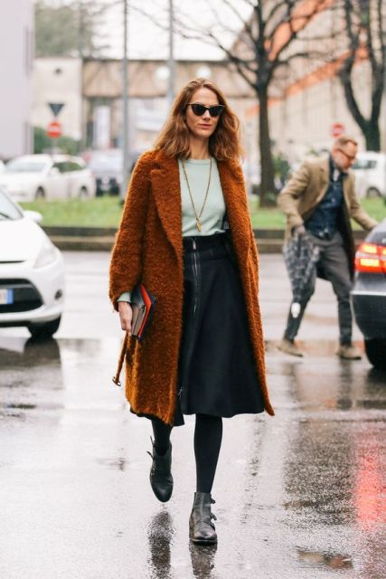 With mint shirt, knee-length skirt and gray boots