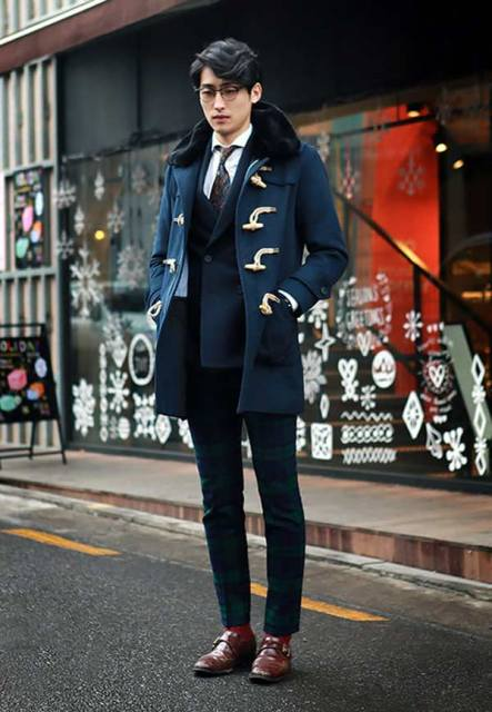 With navy blue jacket, plaid pants and brown shoes