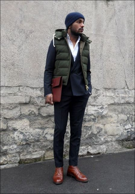 With navy blue suit, leather boots and beanie
