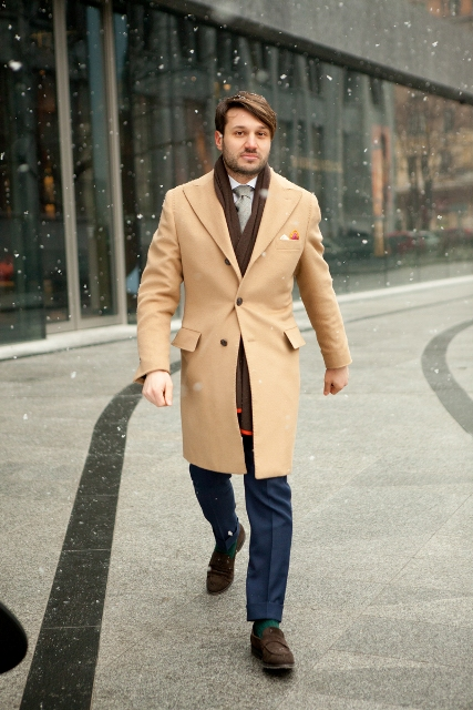 With navy blue trousers, brown scarf and shoes