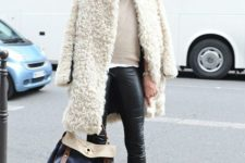 With neutral sweater, skinny pants, mid calf flat boots and leather bag