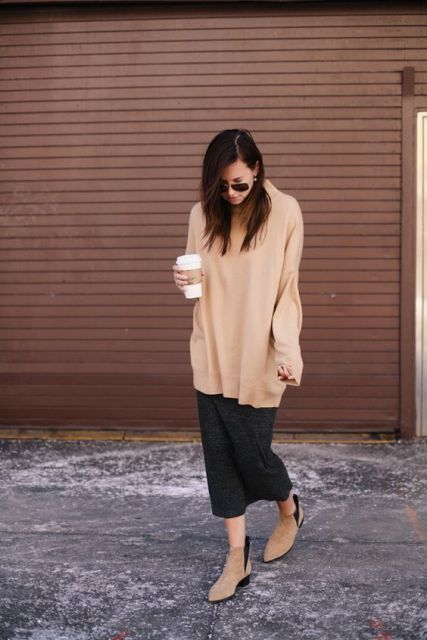 With oversized sweater and midi skirt